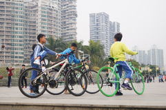 The juvenile and bicycle Stock Photos