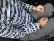 Juvenile delinquent. Arrested girl with hundcuffs inside the car Royalty Free Stock Photo