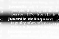 Juvenile delinquent. Word in a dictionary.  concept royalty free stock photos