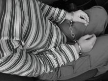 Juvenile delinquent2. Arrested girl with hundcuffs - inside the car royalty free stock photo