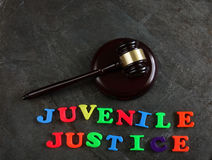 Juvenile Justice gavel. Juvenile Justice spelled out in play letters, with gavel stock photography