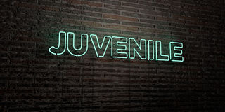 JUVENILE -Realistic Neon Sign on Brick Wall background - 3D rendered royalty free stock image. Can be used for online banner ads and direct mailers Royalty Free Stock Images