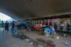 DELHI, INDIA - SEPTEMBER 25, 2017: Unidentified people living in the streets of the city under a bridge juveniles. Juveniles catching sleep on footpath, delhi Stock Photo