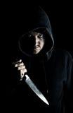 Juventud de intimidación con el cuchillo Imagen de archivo libre de regalías