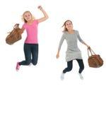 Juventud de salto con los bolsos de escuela Imágenes de archivo libres de regalías