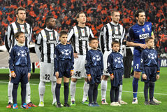 Juventus players with small boys listen anthem Stock Photo