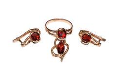 Juwelen met edelstenen van granaat stock foto's