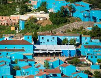 Juzcar, blue Andalusian village in Malaga Stock Photos