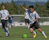 JV 01 dos meninos do futebol Fotos de Stock Royalty Free