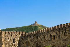 Jvari monastery over the the fortress wall Stock Photos