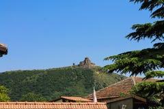 Jvari monastery over the tiled roofs Stock Photos