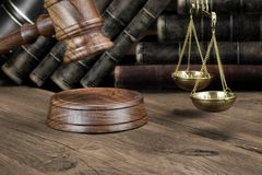 Jydges Gavel, Legal Code And Scales Of Justice Closeup. Closeup Of Jydjes Gavel, Legal Code, Scales Of Justice On The Rough Wooden Background. Law Concept Royalty Free Stock Image