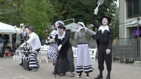 Theater troupe shows a street performance pantomime. Jyvaskyla, Finland - August 17, 2018: Theater troupe Option shows a street performance pantomime Arrival of stock footage