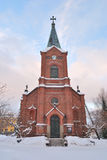 Jyvaskyla, Finland. Lutheran Cathedral. On the background of the early winter sunset Royalty Free Stock Photography
