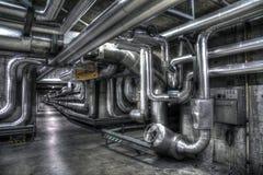 Källare pipelines grey royaltyfri bild