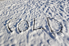 Kälte geschrieben in Schnee Stockfotografie