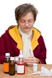Kälte- und Grippejahreszeit Stockfotos
