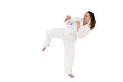 Kämpe som utför karateslagställning Arkivfoto