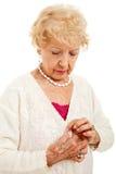 Kämpfen mit Arthritis lizenzfreies stockfoto
