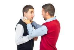 Kämpfen mit zwei Männern Stockbilder