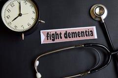 Kämpfen Sie Demenz auf dem Papier mit Gesundheitswesen-Konzept-Inspiration Wecker, schwarzes Stethoskop lizenzfreies stockfoto