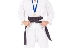 Kämpfer, der mit Medaille um seinen Hals aufwirft Lizenzfreies Stockbild