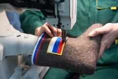 Kängor med ryska statliga symboler Royaltyfri Fotografi
