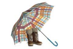 Kängor och ett paraply Royaltyfri Foto