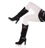 kängor stänger övre för höga ben för kvinnlig slankt royaltyfri bild