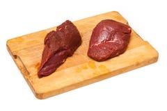 Känguru-Steaks auf Schneidebrett Stockfoto