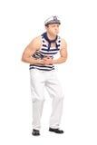 Känslig mageknip för ung manlig sjöman arkivfoto