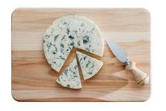 Käse auf Schneidebrett Lizenzfreies Stockfoto