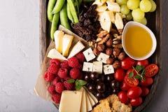 Käse- und Gemüsebrett Stockfotos