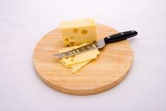Käse und Messer Stockbild