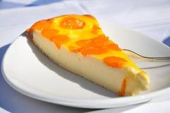 Käsekuchen mit Tangerinen Stockfoto