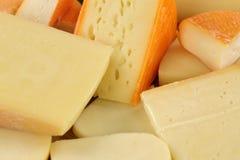 Käseplatte mit Gouda, stark und Schweizer Käse Lizenzfreies Stockfoto