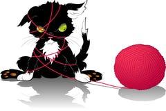 Kätzchen mit einer Kugel des Gewindes Stockfoto