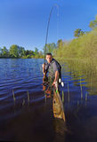 Köderfischen Fang von Fischen, großer Spieß Lizenzfreie Stockfotos