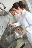 Kök är kontorist tvagningdisk royaltyfria foton