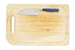 Kökkniv på ett hugga av kvarter Royaltyfri Fotografi