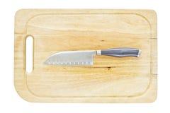 Kökkniv på ett hugga av kvarter Royaltyfria Bilder