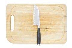 Kökkniv på ett hugga av kvarter Royaltyfri Foto