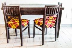 Köksbord och stolar Arkivbild