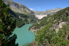 Lower Water Reservoir of Kolnbrein Dam. The Kölnbrein Dam is an arch dam in the Hohe Tauern range within Carinthia Royalty Free Stock Photo