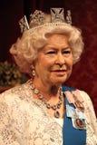 Königin Elizabeth, London, Vereinigtes Königreich - 20. März 2017: Königin Elizabeth II Wachsfigurwachsfigur mit 2 Porträts am Mu Lizenzfreie Stockbilder
