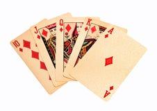 Königliche goldene Spielkarte-Pokerhand des geraden Errötens in den Diamanten Stockfoto