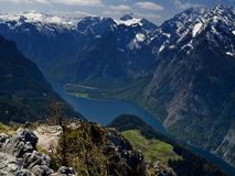 Königsee from the mountains. Königsee, seen from the top of the Jenner, Berchtesgadener Land. On the foreground, rocks and trees; far below, the lake, with Royalty Free Stock Photo
