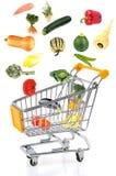 Köp av grönsaker på wwhitebakgrund arkivfoton
