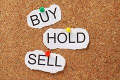 Köp hållen eller sälj? Royaltyfria Foton