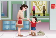 Köpande skor för hennes unge Arkivfoton
